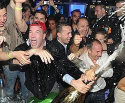 Don Johnson pops champagne